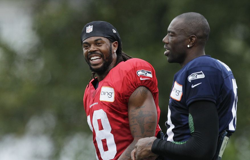Seattle Seahawks wide receivers Terrell Owens, right, and Sidney Rice, left, during NFL football training camp, Wednesday, Aug. 8, 2012, in Renton, Wash. (AP Photo/Ted S. Warren)