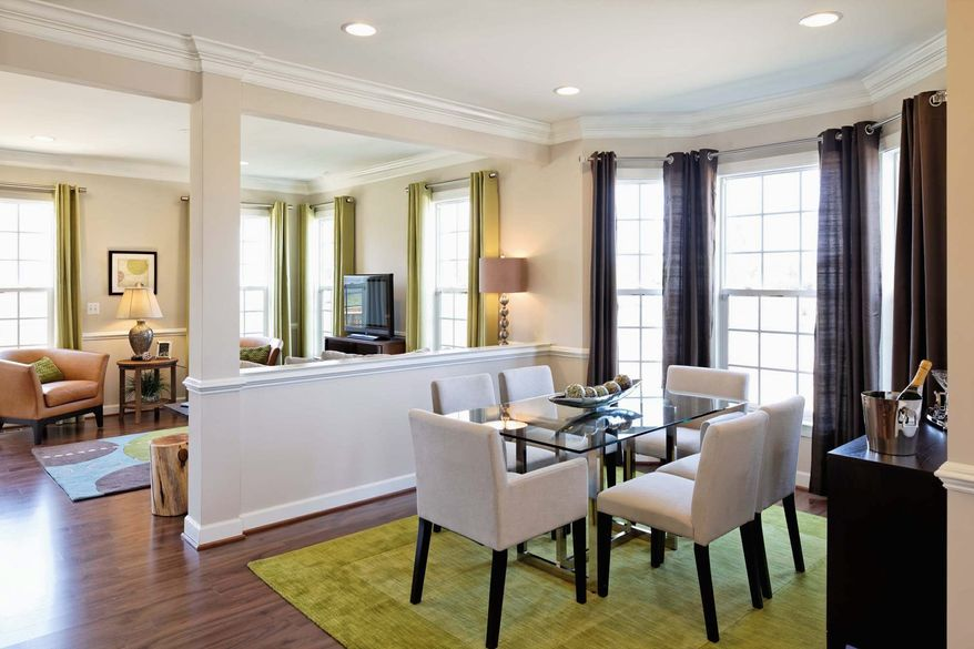 Buyers of the Andover model can choose to have a knee wall and column between the dining room and family room.