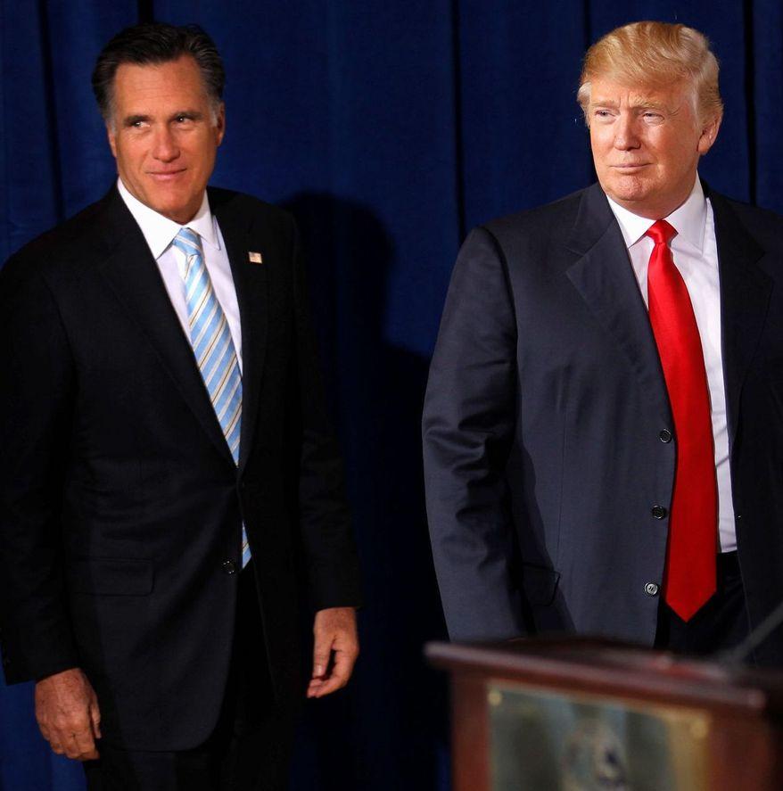 Mitt Romney (left) and Donald Trump stump in Las Vegas in August. (Associated Press)