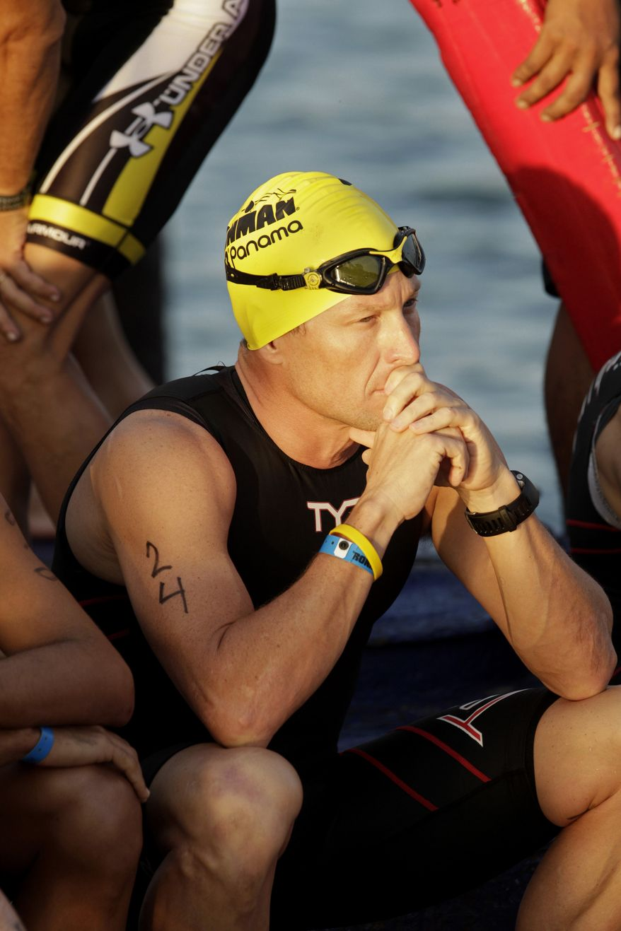 FILE - This Feb. 12, 2012 file photo shows seven-time Tour de France winner Lance Armstrong waiting for the start of the Ironman Panama 70.3 triathlon in Panama City, Panama. A federal judge in Austin, Texas, has thrown out Lance Armstrong's lawsuit against the U.S. Anti-Doping Agency, an attempt to stop the drug case against the seven-time Tour de France winner.     (AP Photo/Arnulfo Franco, File)