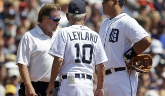 Detroit Tigers third baseman Miguel Cabrera talks with manager Jim Leyland and athletic trainer Steve Carter during the second inning of a baseball game against the Toronto Blue Jays, Thursday, Aug. 23, 2012, in Detroit. Cabrera left the game. (AP Photo/Paul Sancya)