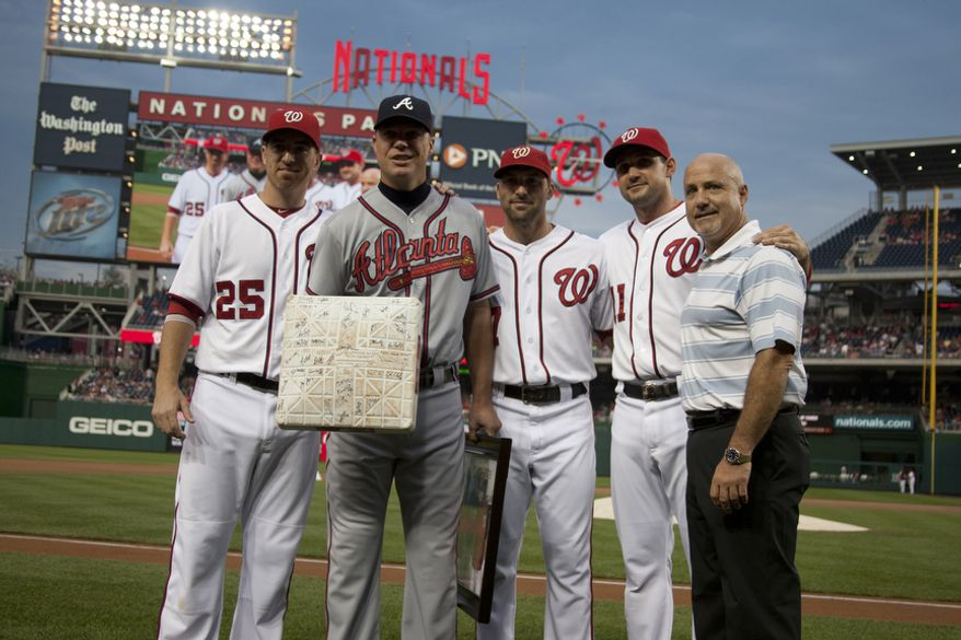 Washington Nationals, Adam LaRoche, Mark DeRosa, Ryan Zimmerman and General Manager Mike Rizzo, present gifts to Chipper Jone, Wednesday, Aug. 22, 2012, in Washington, DC. Jones said he would be retiring after this session. He has played his entire 19 year career was an Atlanta Brave, winning one World Series title with them in 1995. (Craig Bisacre/The Washington Times)