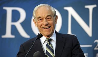 ** FILE ** In this March 28, 2012, photo, former Republican presidential candidate Rep. Ron Paul of Texas appears at a town hall meeting in College Park, Md. (AP Photo/Cliff Owen, File)