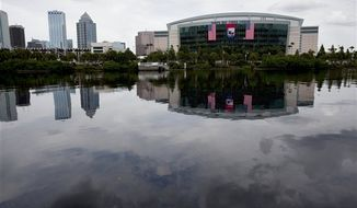 The Tampa Bay Times Forum, site of the 2012 Republican National Convention, is viewed across the water of the Garrison Channel from Harbour Island in downtown Tampa, Fla. Weather forecasts continue to show Florida in the path of Tropical Storm Isaac. (AP Photo/The Tampa Bay Times, Carolina Hidalgo)