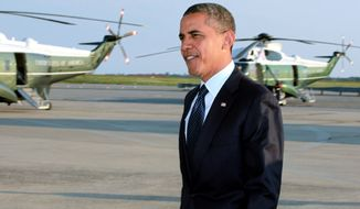 President Obama arrives Aug. 22, 2012, at JFK International Airport in New York en route to a visit in New York City, where he planned to attends several fundraiser events. (Associated Press)