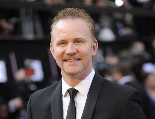 "** FILE ** This Feb. 26, 2012 photo shows filmmaker Morgan Spurlock at the 84th Academy Awards in Los Angeles. Spurlock is coming to CNN for a new weekend series that will take a close look at areas of American life that don't normally get much attention. The series ""Inside Man"" will look at gun lovers, marijuana growers, end of life caregivers and migrant farmworkers in its early episodes. (AP Photo/Chris Pizzello, file)"