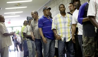 Job seekers wait in line at a construction job fair in New York on Tuesday, Aug. 21, 2012. (AP Photo/Seth Wenig)