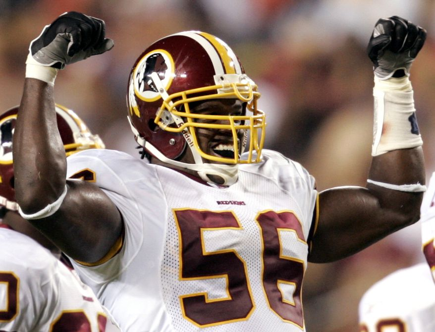 Washington Redskins linebacker LaVar Arrington flexes his muscles in the third quarter of a preseason game against the Pittsburgh Steelers on Friday, Aug. 26, 2005 in Landover, Md. This was Arrington's first game back after he missed most of last season with a knee injury. The Redskins won 17-10. (AP Photo/Evan Vucci)