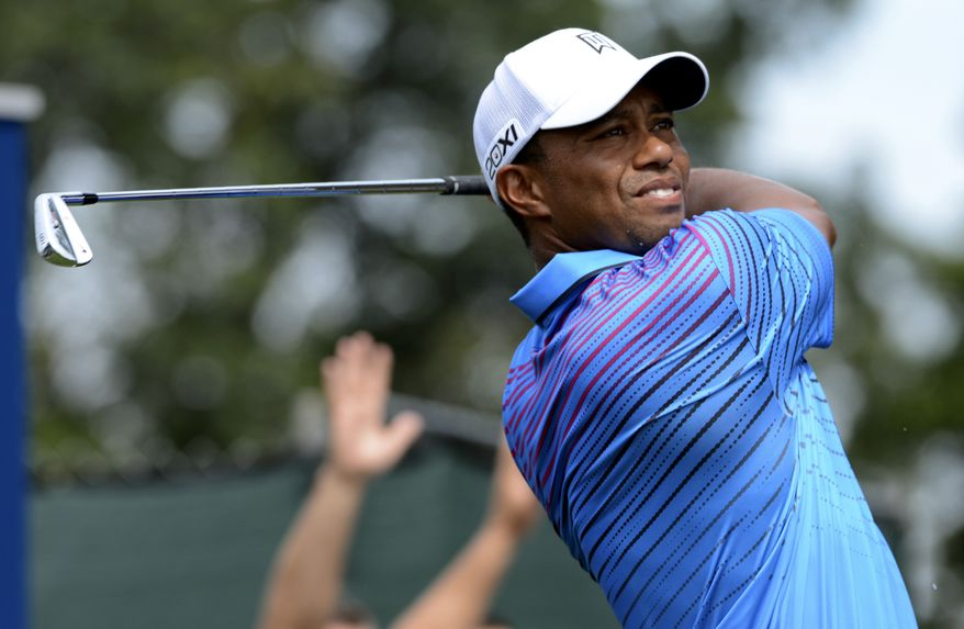 Tiger Woods hits his tee shot on the third hole during the second round of The Barclays golf tournament at Bethpage State Park in Farmingdale, N.Y., Friday, Aug. 24, 2012. (AP Photos/Henny Ray Abrams)