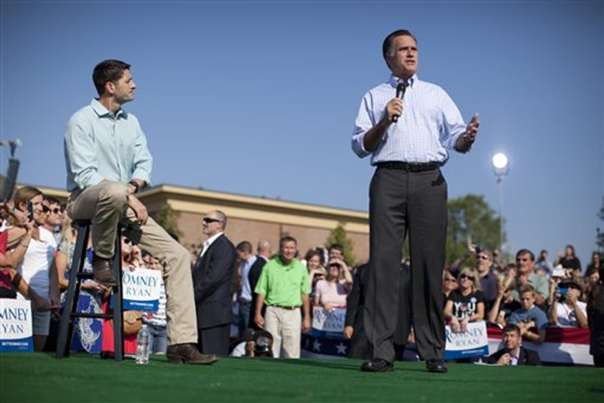 Republican presidential candidate, former Massachusetts Gov. Mitt Romney speaks as vice presidential running mate Rep. Paul Ryan, R-Wis., looks on during a campaign rally on Saturday, Aug. 25, 2012 in Powell, Ohio. (AP Photo/Evan Vucci)