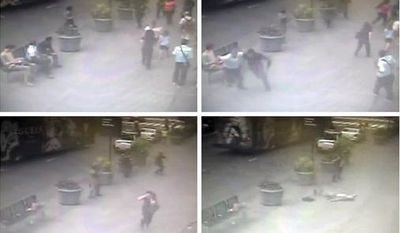 In this sequence of images taken from a surveillance video camera and released by the New York City Police Department, police officers approach Jeffrey Johnson, after he shot his former colleague Steven Ercolino, near the Empire State Building in New York, Friday, Aug. 24, 2012. Johnson, upper left in frames, was shot and killed by police as bystanders fled. (AP Photo/New York City Police Department)