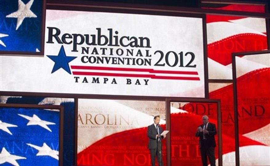 ** FILE ** Republican National Committee Chairman Reince Priebus, left, and convention CEO William Harris unveil the stage and podium for the 2012 Republican National Convention, Monday, Aug. 20, 2012, at the Tampa Bay Times Forum in Tampa, Fla. (AP Photo/Scott Iskowitz)