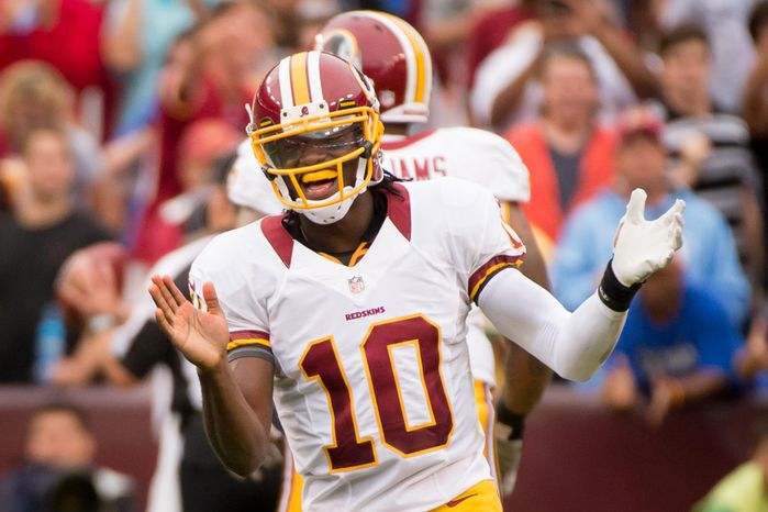 Washington Redskins quarterback Robert Griffin III (10) celebrates a touchdown in the second quarter to put the Skins up 14-7 as the Washington Redskins takes on the Indianapolis Colts in NFL preseason football at FedEx Field, Landover, Md., Saturday, August 25, 2012. (Andrew Harnik/The Washington Times)
