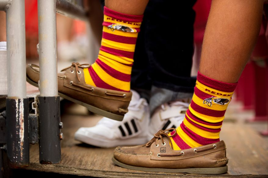A Washington Redskins fan wears redskins sox as the Washington Redskins take on the Indianapolis Colts in NFL preseason football at FedEx Field, Landover, Md., Saturday, August 25, 2012. Washington Redskins quarterback Robert Griffin III (10) has become known for wearing unique sox. (Andrew Harnik/The Washington Times)