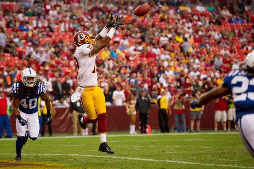 Washington Redskins wide receiver Dezmon Briscoe (19) catches a 12-yard touchdown pass from Washington Redskins quarterback Rex Grossman (8) in the fourth quarter as the Washington Redskins take on the Indianapolis Colts in NFL preseason football at FedEx Field, Landover, Md., Saturday, August 25, 2012. (Andrew Harnik/The Washington Times)