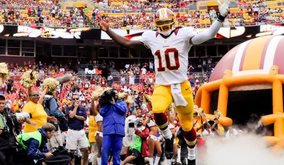 Washington Redskins quarterback Robert Griffin III (10) is introduced before his first game at FedEx Field, Landover, Md. Aug. 25, 2012. (Preston Keres/Special to The Washington Times)