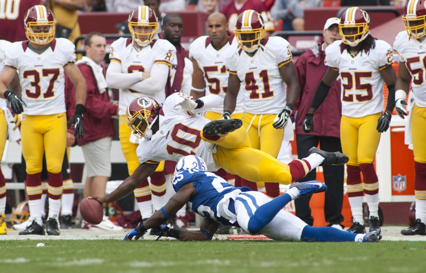 Washington Redskins quarterback Robert Griffin III (10) runs for a first down in the first half of the Indianapolis Colts at Washington Redskins preseason football game, Saturday, August 25, 2012 in Washington, DC. (Craig Bisacre/The Washington Times)