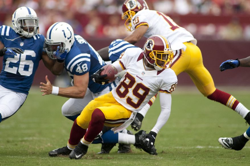 Washington Redskins wide receiver Santana Moss (89) breaks tackles during first half action of the Indianapolis Colts at Washington Redskins preseason football game, Saturday, August 25, 2012 in Washington, DC. (Craig Bisacre/The Washington Times)