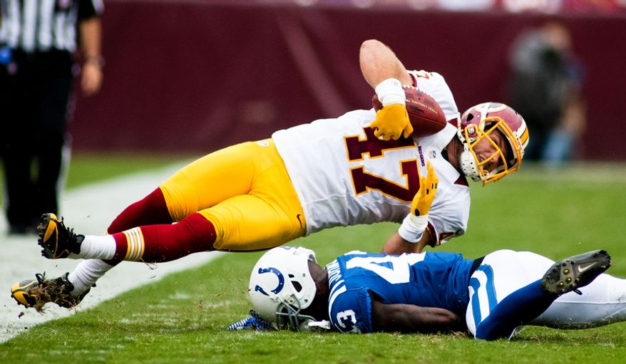 Washington Redskins tight end Chris Cooley (47) is hit by Indianapolis Colts defensive back DJ Johnson (43) during first half action of the Indianapolis Colts at Washington Redskins preseason football game, Saturday, August 25, 2012 in Washington, DC. (Craig Bisacre/The Washington Times)