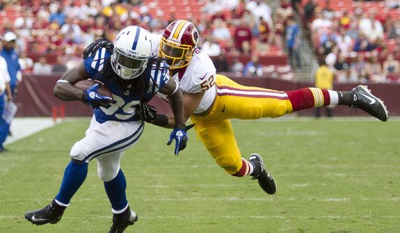 Washington Redskins linebacker Keenan Robinson (52) tackles Indianapolis Colts cornerback Cameron Chism (39) before he could reach the end zone in second half action of the Indianapolis Colts at Washington Redskins preseason football game, Saturday, August 25, 2012 in Washington, DC. (Craig Bisacre/The Washington Times)