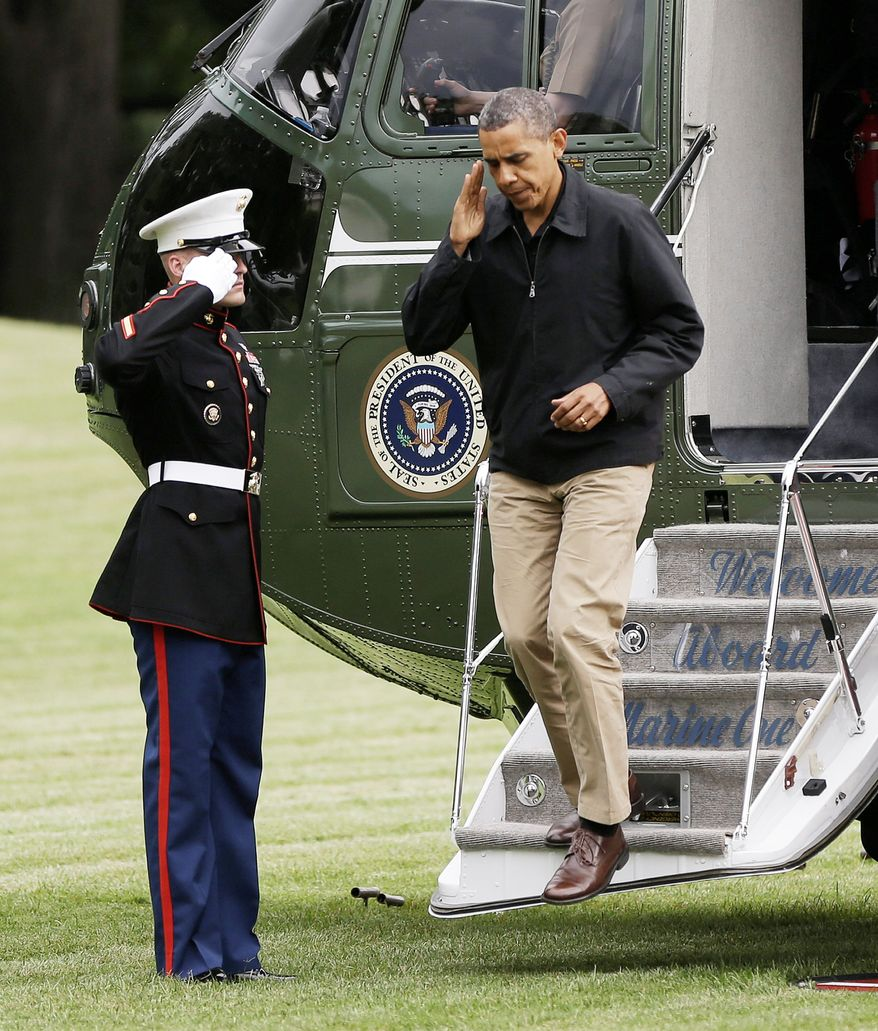 President Obama steps off the Marine One helicopter upon arrival on the South Lawn of the White House in Washington on Sunday. His convention is next week. (Associated Press)