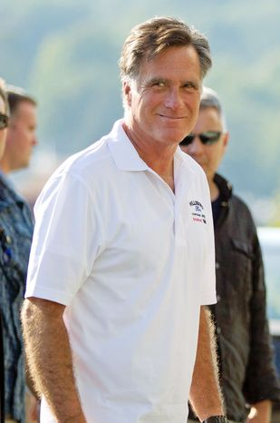 Former Massachusetts Gov. Mitt Romney, the presumptive Republican presidential nominee, enters Brewster Academy in Wolfeboro, N.H., for convention preparations on Sunday. (Associated Press)