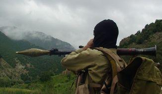 ** FILE ** A Pakistani Taliban militant holds a rocket-propelled grenade at the Taliban stronghold of Shawal, in the Pakistani tribal region of Waziristan, Pakistan, on Sunday, Aug. 5, 2012. (AP Photo/Ishtiaq Mahsud)