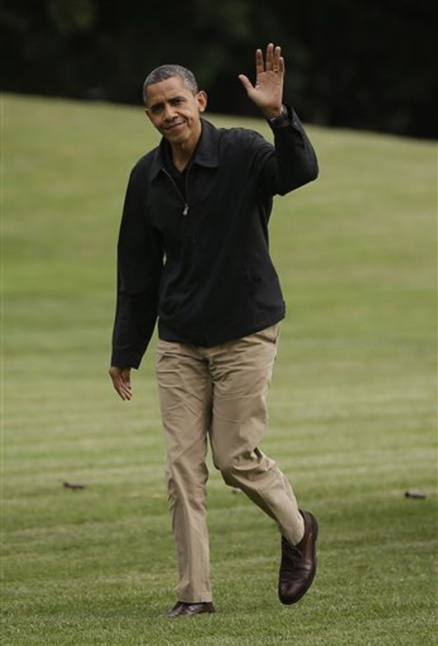 President Barack Obama waves as he walks across the South Lawn of the White House after returning from Camp David on Marine One helicopter, Sunday, Aug., 26, 2012. (AP Photo/Pablo Martinez Monsivais)