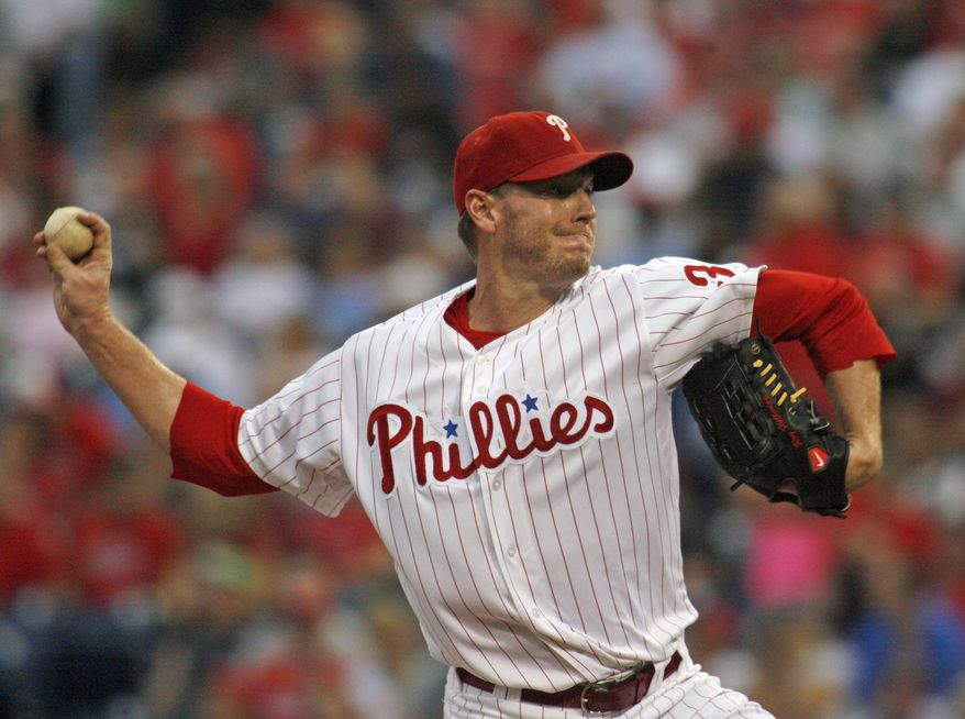 Philadelphia Phillies starting pitcher Roy Halladay throws against the Washington Nationals in the first inning of a baseball game Saturday, Aug. 25, 2012, in Philadelphia. (AP Photo/H. Rumph Jr)
