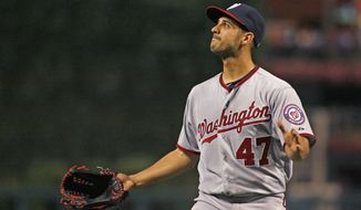 Washington Nationals starting pitcher Gio Gonzalez leaves the game against the Philadelphia Phillies in the sixth inning of a baseball game Saturday, Aug. 25, 2012, in Philadelphia. The Phillies won 4-2. (AP Photo/H. Rumph Jr)