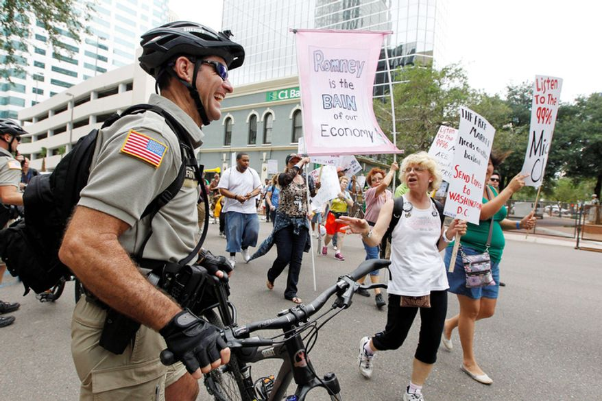 A demonstrator speaks to a police officer during a protest march in Tampa, Fla.  (AP Photo/Chris O'Meara)