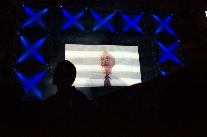 """A video montage of Ron Paul is played on a large screen before he speaks at the """"We Are the Future Rally"""" at the Sun Dome at the University of South Florida.   (Andrew Harnik/The Washington Times)"""