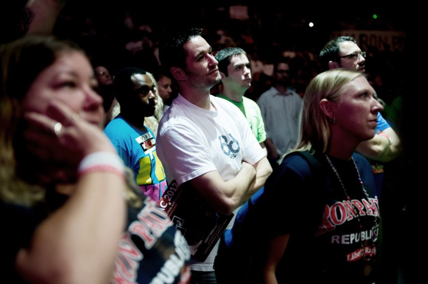 """Supporters listen as Ron Paul speaks at the """"We Are the Future Rally"""".   (Andrew Harnik/The Washington Times)"""