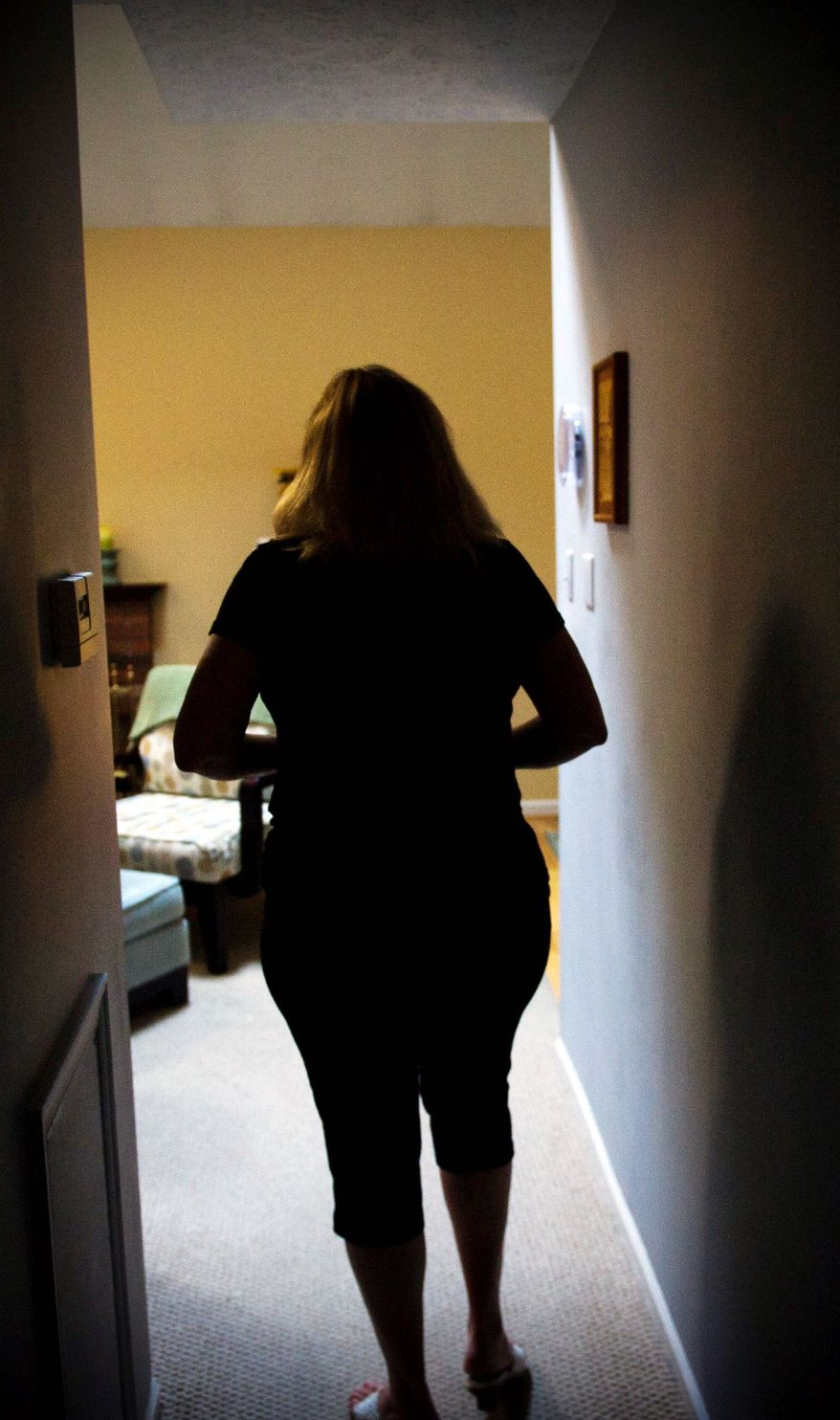 Terri Doring lost her secretarial job at a Philadelphia law firm in 2009. She now is on the verge of losing much of what remains of her middle-class lifestyle and is scrambling to make mortgage payments on her town house. (Rod Lamkey Jr./The Washington Times)