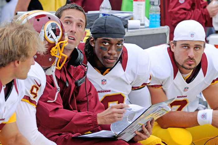 Washington Redskins Offensive Coordinator Kyle Shanahan and quarterback Robert Griffin III look at the jumbotron late as they talk on the bench in the second quarter at FedEx Field, Landover, Md. Aug. 25, 2012. (Preston Keres/Special to The Washington Times)