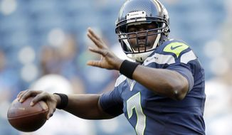 FILE - In this Aug. 11, 2012, file photo, Seattle Seahawks quarterback Tarvaris Jackson (7) warms up prior to an NFL football preseason game against the Tennessee Titans in Seattle. A person familiar with discussions told The Associated Press on Sunday, Aug. 26, on the condition of anonymity that the Buffalo Bills have tentatively agreed to acquire Jackson in a trade with the Seahawks. (AP Photo/Stephen Brashear, File)