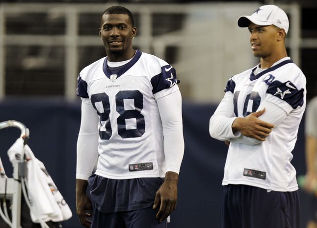 Dallas Cowboys wide receiver Dez Bryant (88) sits out a workout with Miles Austin (19) during NFL football practice at Cowboys Stadium, Thursday, Aug. 23, 2012, in Arlington, Texas. (AP Photo/LM Otero)