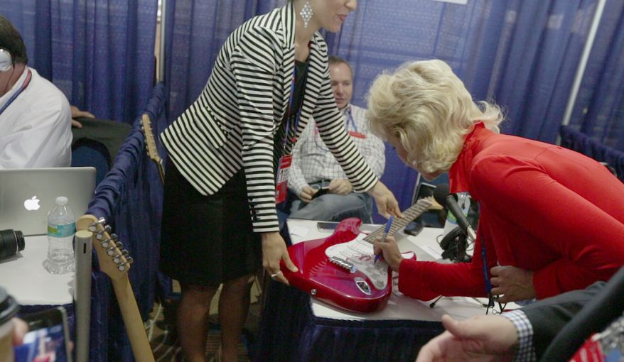 Janine Turner, famous for her role in the T.V. series Northern Exposure, signs a guitar for Mike Huckabee's radio show at the National Republican Convention (RNC), in Tampa, FL., Monday, August 27, 2012. The RNC will run from the 27th through the 30th of August.(Andrew S. Geraci/The Washington Times)