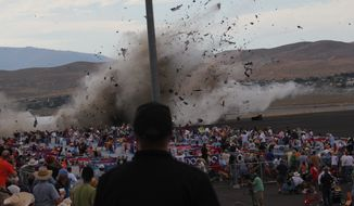 FILE - In this Sept. 16, 2011 file photo, A P-51 Mustang airplane crashes into the edge of the grandstands at the Reno Air show in Reno, Nev, leaving 11 people dead and 70 seriously injured. The National Transportation Safety Board, meeting in Washington, will determine the cause of the September 2011 crash of a modified World War II-era fighter plane into a spectator area during the 2011 National Championship Air Races in Reno on Monday, Aug. 27, 2012. (AP Photo/Ward Howes, File)