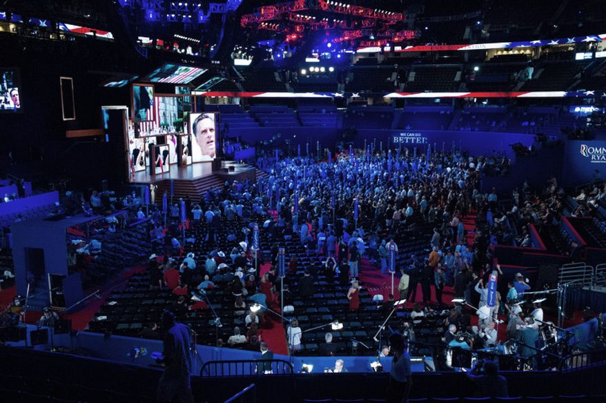 Images on the jumbotron after the recess was called during the first day of the Republican National Convention.   (Andrew Harnik/The Washington Times)