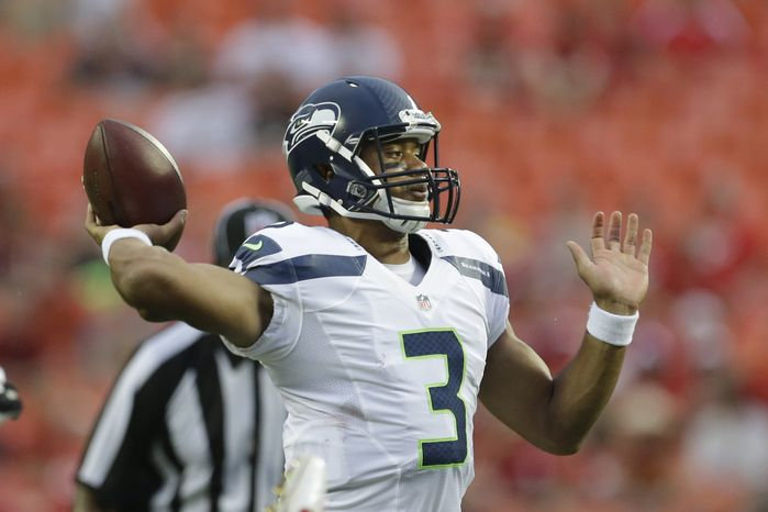 Seattle Seahawks quarterback Russell Wilson (3) passes to a teammate during the first half of an NFL preseason football game against the Kansas City Chiefs in Kansas City, Mo., Friday, Aug. 24, 2012. (AP Photo/Charlie Riedel)