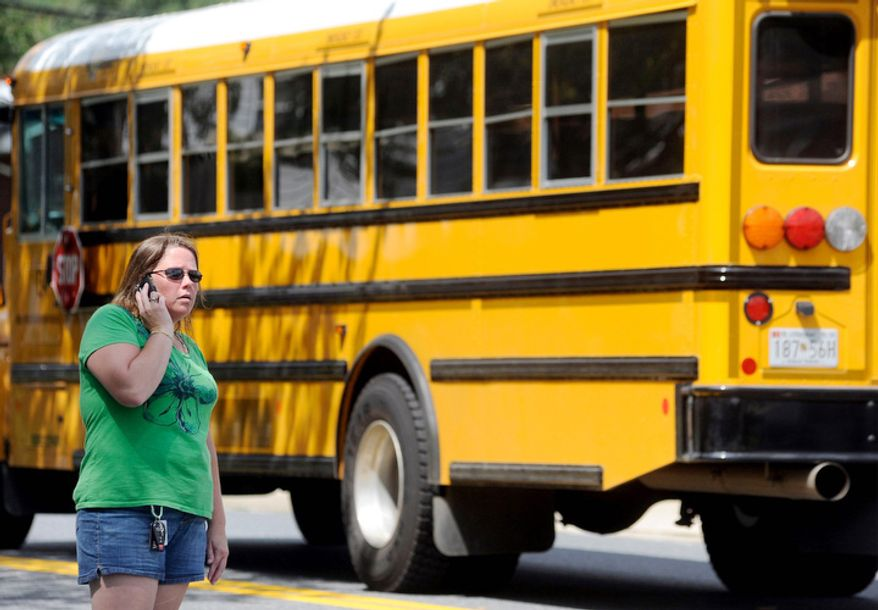 Becky Hobgood tries to locate her daughter after a student was shot and critically wounded on the first day of classes Perry Hall High School. (AP Photo/Steve Ruark)