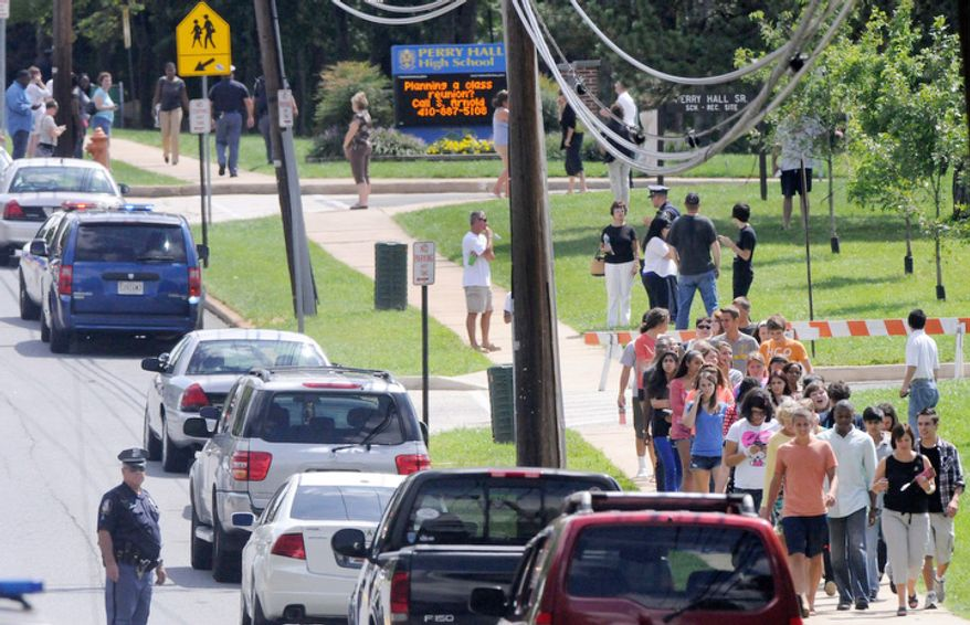 Students evacuate Perry Hall High School after a student was shot and critically wounded on the first day of classes Monday, Aug. 27, 2012, in Perry Hall, Md. A suspect was taken into custody shortly after the shooting, according to police. No one else was reported injured. (AP Photo/Steve Ruark)