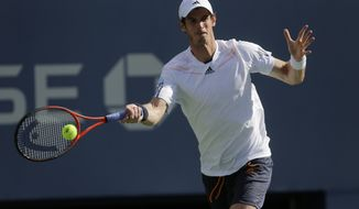 Britain's Andy Murray returns a shot to Alex Bogomolov Jr., of Russia, at the 2012 US Open Tennis tournament, Monday, Aug. 27, 2012, in New York. (AP Photo/Mike Groll)