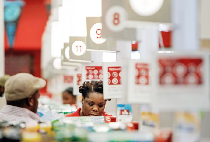 associated press A cashier rings up a sale at a Target store in Chicago last week. A private research group says that consumer confidence unexpectedly fell this month to the lowest level since November 2011. The New York-based Conference Board said Tuesday that its consumer confidence index fell to 60.6, down from a revised 65.4 in July. Economists had expected a reading of 66.