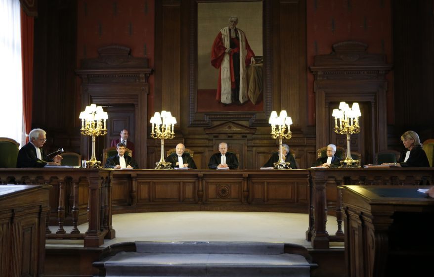 Judge Albert Fettweis (center) presides over a hearing for Michelle Martin at the Court of Cassation at the Justice Palace in Brussels on Tuesday, Aug. 28, 2012. Belgium's highest court granted conditional early release to Martin, one of the nation's most despised criminals, even though, as the accomplice and former wife of a pedophile and child killer, she let two of his victims starve to death. (AP Photo)