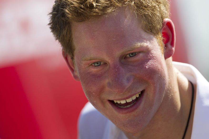 **FILE** Britain's Prince Harry smiles March 10, 2012, after playing rugby at Flamengo's beach in Rio de Janeiro. (Associated Press)