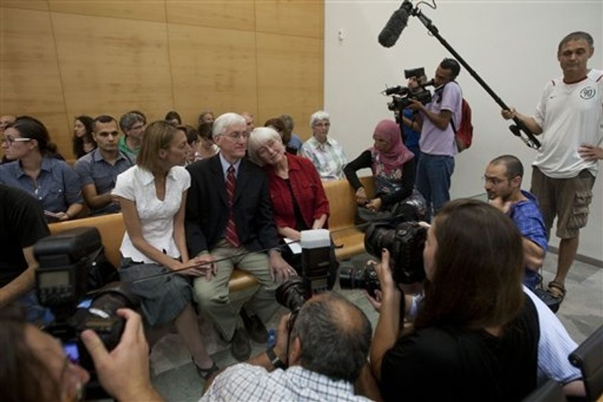 Cindy, center right, and Craig Corrie, center, the parents of Rachel Corrie, a pro-Palestinian activist who was killed by an Israeli bulldozer in Gaza in 2003, sit together with their daughter Sarah, center left, in the court room just before the district court's ruling in Haifa, Israel, Tuesday, Aug. 28, 2012. (AP Photo/Ariel Schalit)
