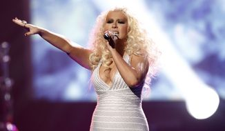 Christina Aguilera performs at the 39th annual American Music Awards in Los Angeles in November 2011. (AP Photo/Matt Sayles)
