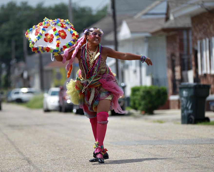 Jennifer Jones, a Grand Marshal for various bands and events, poses for a photo in the Treme section of New Orleans, Thursday, Aug. 23, 2012. (AP Photo/Gerald Herbert)
